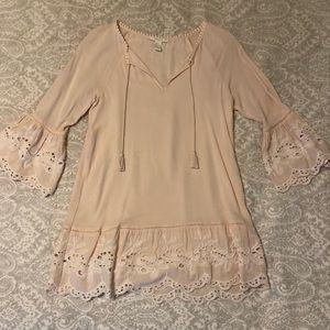 Blush pink mini dress with crochet detailing